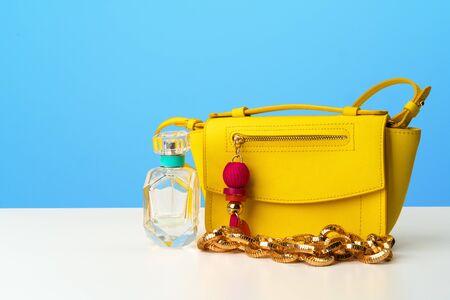 Female handbag with accessories flat lay top view