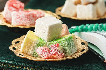 Close up of a little oriental plate with turkish delights sweets