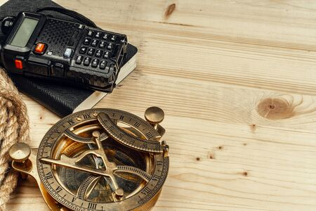Tourist set with walkie talkie on wooden background. Close up.