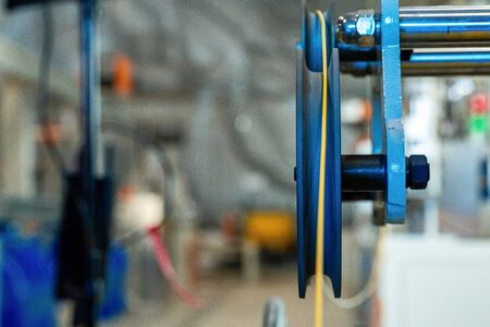 Cable production. Close up of a cable reel, manufacturing zone
