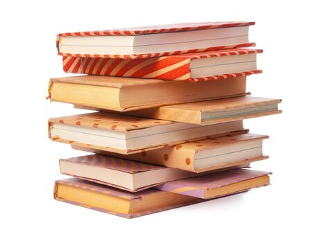 pile of books isolated on white background. Close up.