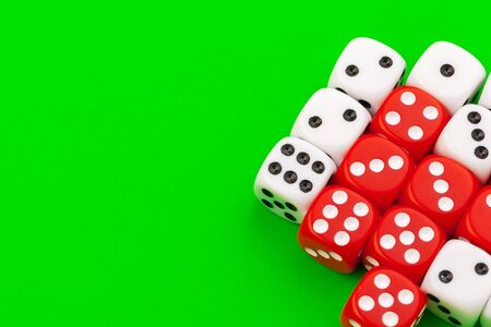 Sport dice on green background. Close up. Stock Photo