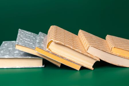 books isolated on green background. Close up.