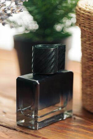 Men perfume. Bottle spray. Macro photo. Close up.