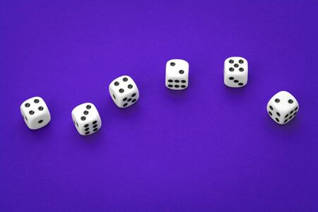 White dices against a blue background
