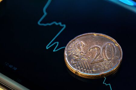 Euro coin on stock chart. Financial investment concept. Close up. Imagens
