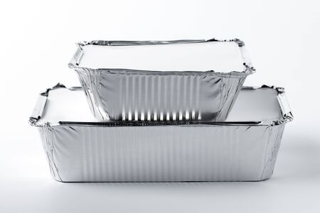 Foil food box with takeaway meal on white background close up Stock Photo