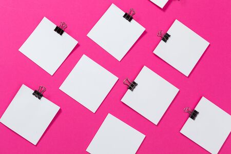 mock up concept. cards Papers on pink background. Top view, flat lay, copy space. Close up.