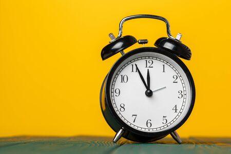 retro alarm clock on table Banco de Imagens