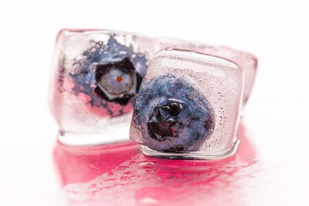 Berry ice cubes for decorating beverages close up