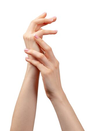 Well-groomed female hands with manicure on white background close up