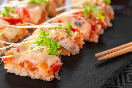 fresh sushi on rustic wooden table. Close up.