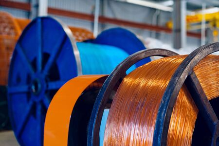 Production of copper wire, cable in reels at factory. Cable factory. Close up.