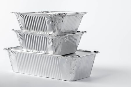 Foil food box with takeaway meal on white background close up