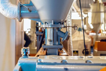 Close up photo of production in the industry with various machines Reklamní fotografie