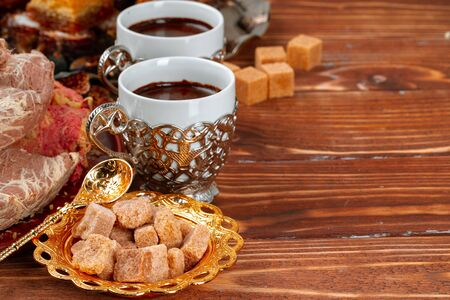 Two cups of coffee with traditional turkish desserts