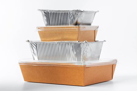 Assortment of food delivery containers on white background close up
