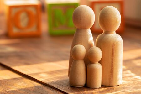 Small wooden figures of family members close up. Family relationship symbol Фото со стока
