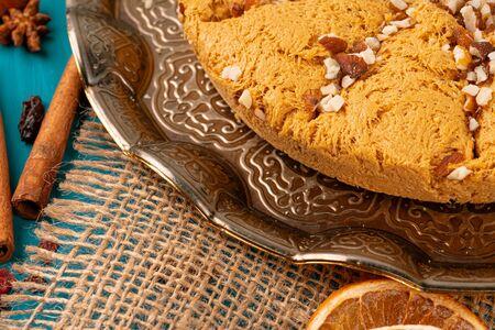 Turkish delight dessert on traditional tableware on dark blue table