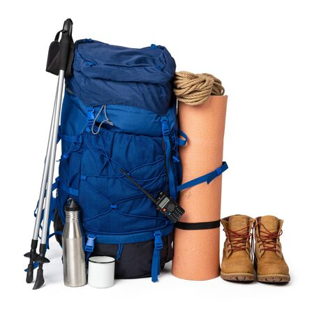 Blue hiking backpack with fitness mat isolated on white Stockfoto