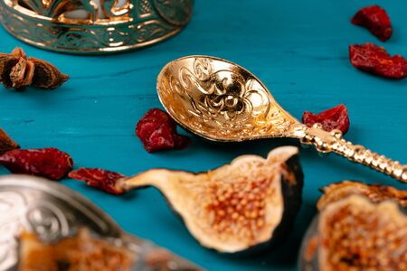 Turkish metal tableware on wooden table close up