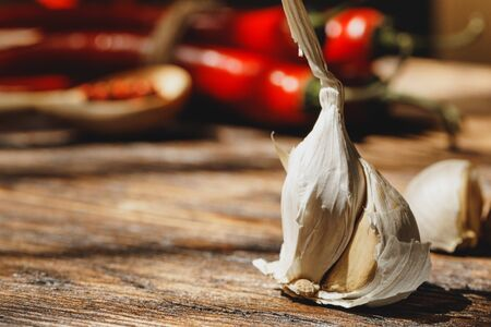 Garlic and chili pepper on dark wooden table Imagens