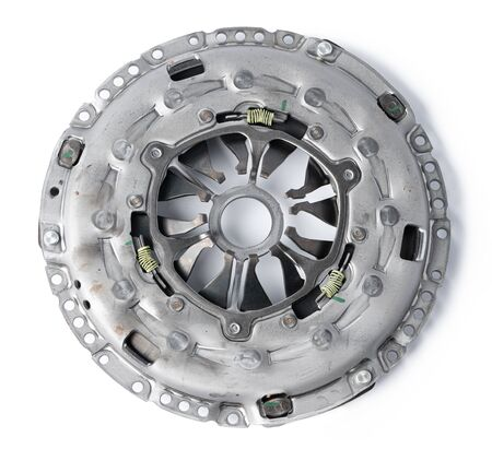 New automotive clutch on a white background. Close up.