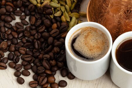 Cup of coffee with roasted beans, seeds and cinnamon Banque d'images
