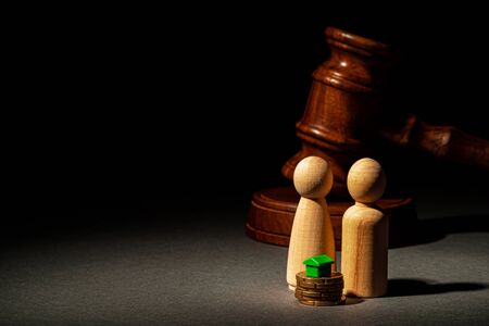 Divorse property division concept. Wooden family with house and judge gavel Stock Photo
