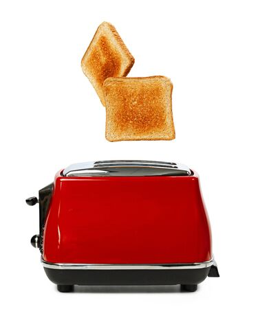 Two toasts jumping out of red toaster against white background