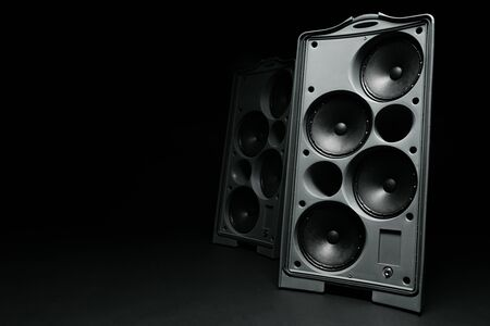 Audio system stereo column on dark background close up