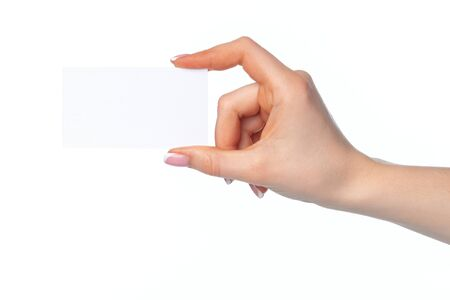 Beautiful female hand holding white business card on white background