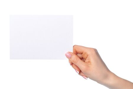 Womans hand holding blank white sheet of paper isolated on white