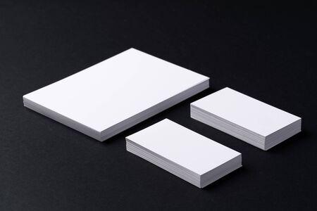 White blank business cards on dark black background 스톡 콘텐츠