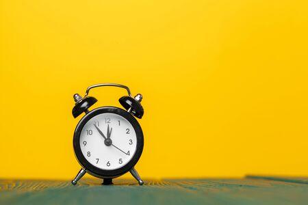 retro alarm clock on table Foto de archivo