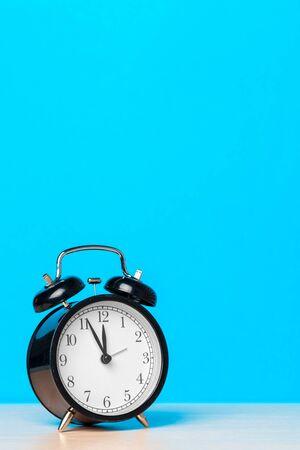 retro alarm clock on table. creative photo.