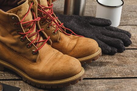 Close up photo of hiking boots and utility knife Stock Photo