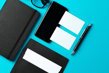 White businesscard with copy space on black notepad, close up 写真素材