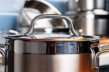 Set of aluminum cookware on kitchen counter close up