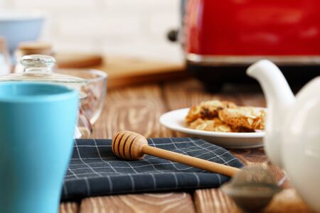 Close up photo of a red toaster on a wooden kitchen table Stock Photo