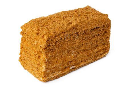 Piece of honey cake isolated on white