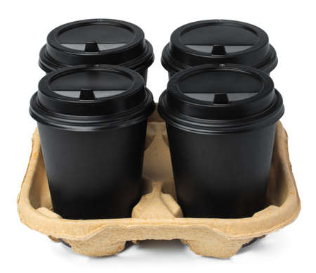 Four black takeaway cups of coffee in a tray isolated on white background