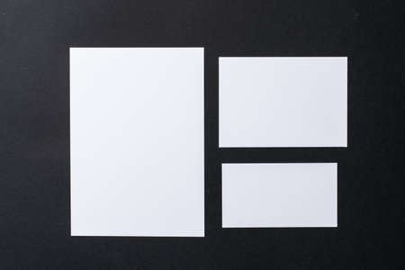 White blank business cards on dark black background, copy space Stock Photo