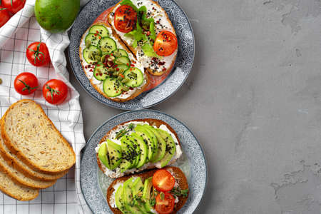 Toasted avocado sandwich for breakfast, top view. Vegan food