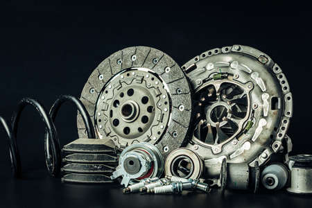 Car parts. Break disc on black background close up