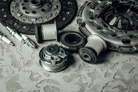 Car parts on grey textured concrete background, copy space