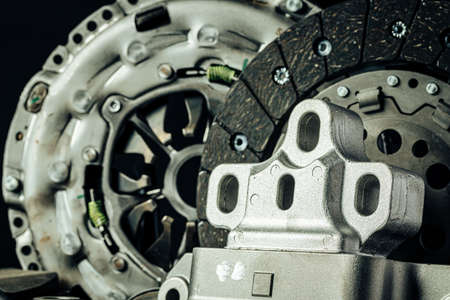 Close up of set of new car parts on black background