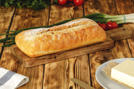Fresh baked loaf of bread with butter bar