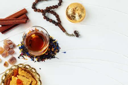 Cup of tea with cinnamon sticks on table Archivio Fotografico