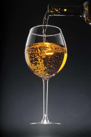Glass of wine on black background, close up Archivio Fotografico